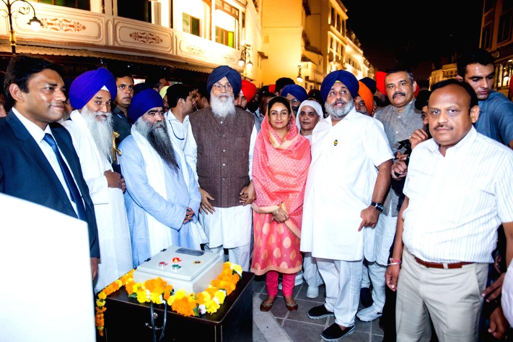 Punjab Chief Minister Parkash Singh Badal, Deputy Chief Minister Sukhbir Singh Badal and Union Minister Vijay Sampla during inauguration of Amritsar Beautification Project on Oct 25, 2016. - Parkash Singh Badal and Sukhbir Singh Badal