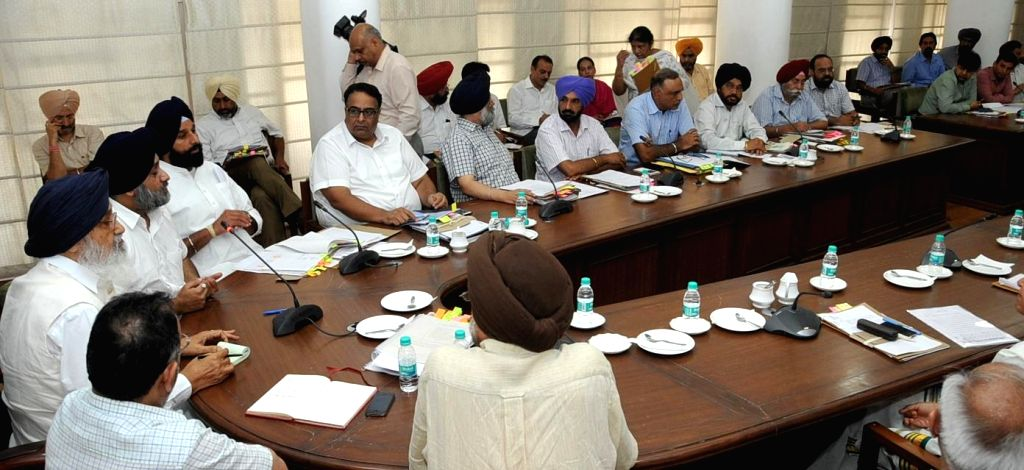 Punjab Chief Minister Parkash Singh Badal during a meeting with senior officials of the state to review progress of protective measures for floods at Chief Minister's Office in Chandigarh on July .. - Parkash Singh Badal