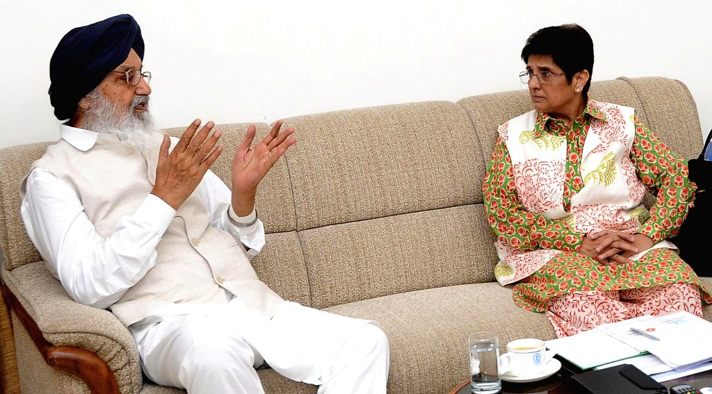 Punjab Chief Minister Parkash Singh Badal during a meeting with former IPS officer and social activist Kiran Bedi in New Delhi on July 9, 2014.