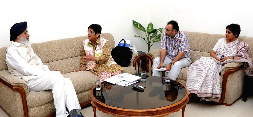 Punjab Chief Minister Parkash Singh Badal during a meeting with former IPS officer and social activist Kiran Bedi and others in New Delhi on July 9, 2014.