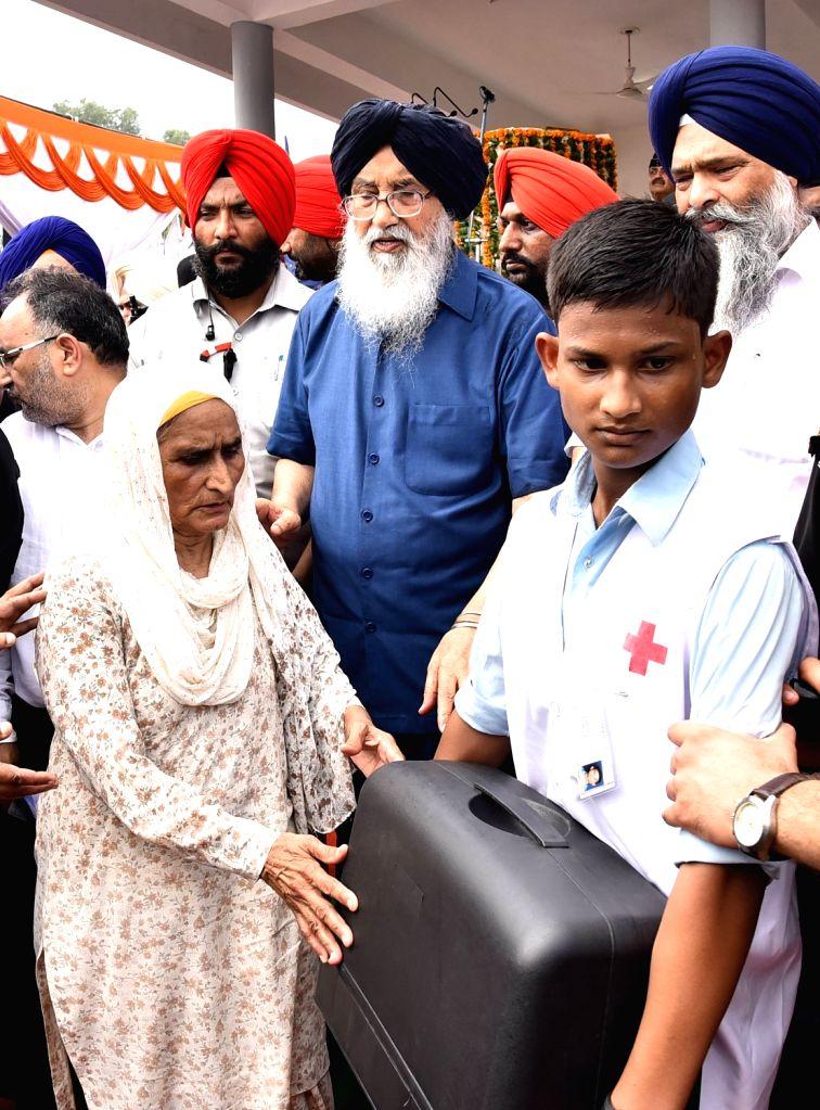 Punjab Chief Minister Parkash Singh Badal during Independence Day programme in Mohali on Aug 15, 2016. - Parkash Singh Badal
