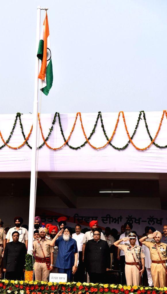 Punjab Chief Minister Parkash Singh Badal hoists the national flag on Independence Day programme in Mohali on Aug 15, 2016. - Parkash Singh Badal