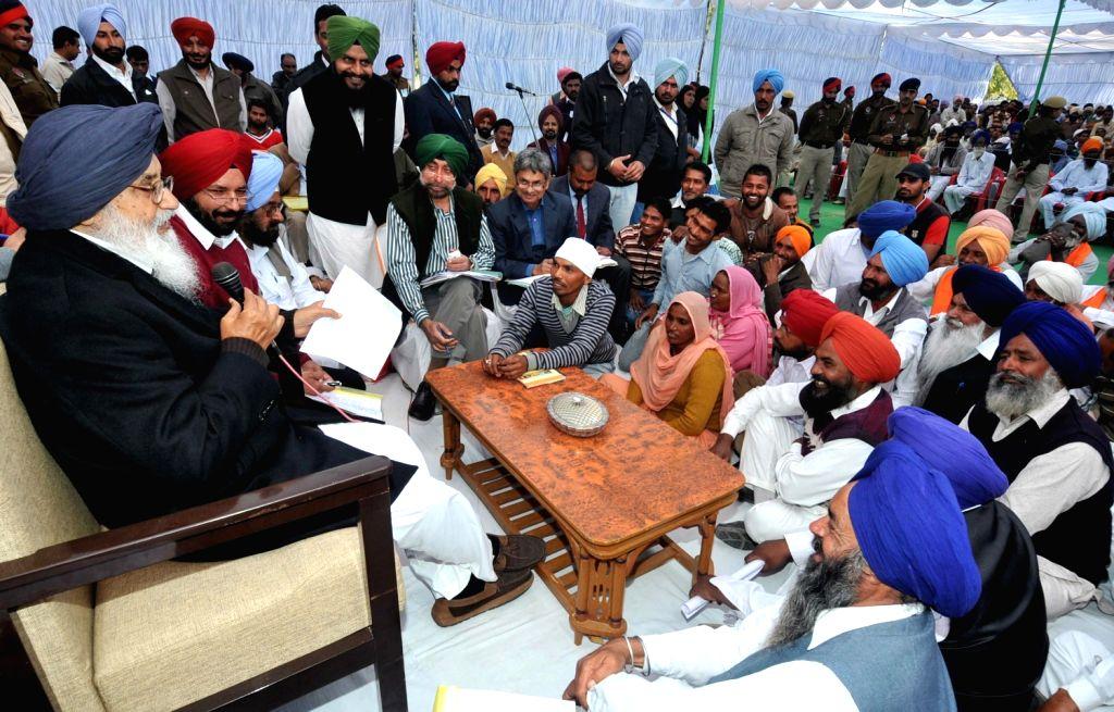 Punjab Chief Minister Parkash Singh Badal  listens to grievance of people during Sangat Darshan Function in Lambi of Junjab on Dec.6, 2013.