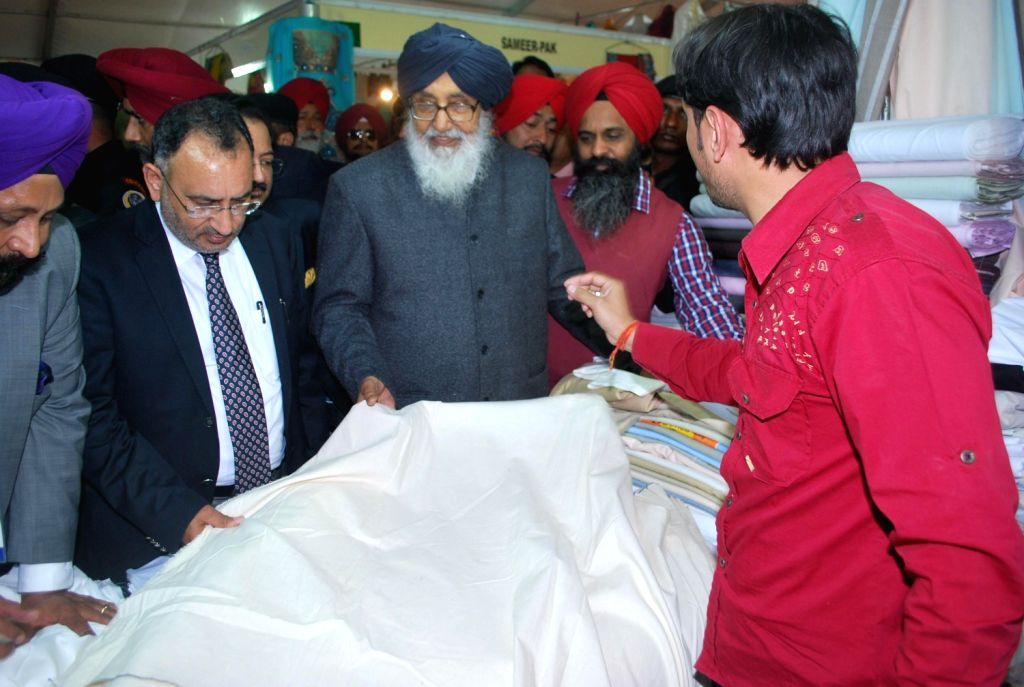 Punjab Chief Minister Parkash Singh Badal visits a stall in during a Valedictory Ceremony of the 8th edition of the Punjab International Trade Expo (PITEX) 2013 organised by PHD Chamber in Amritsar ..