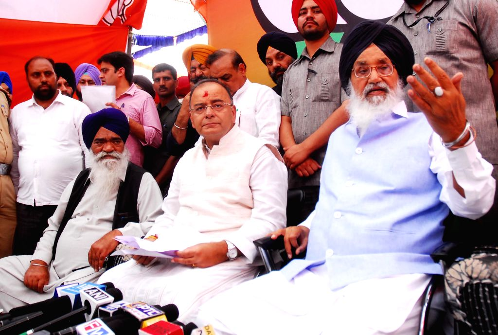 Punjab Chief Minister Parkash Singh Badal with BJP candidate for 2014 Lok Sabha Election from Amritsar, Arun Jaitley during a press conference  in Ajnala near Amritsar on April 16, 2014.