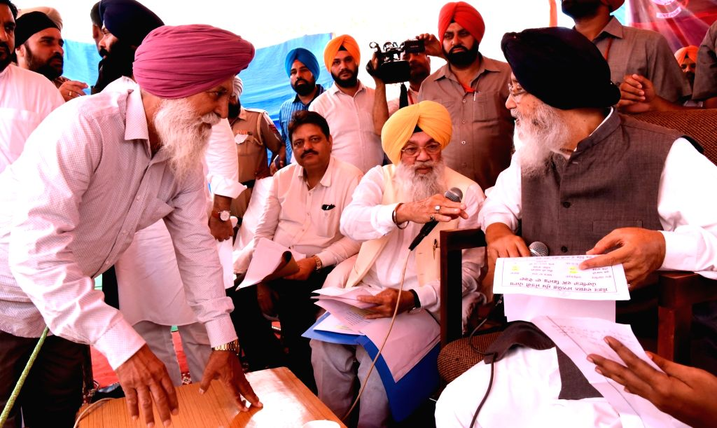 Punjab Chief Minster Parkash Singh Badal interacts with people during a Sangat Darshan programme near Amritsar on June 28, 2016.