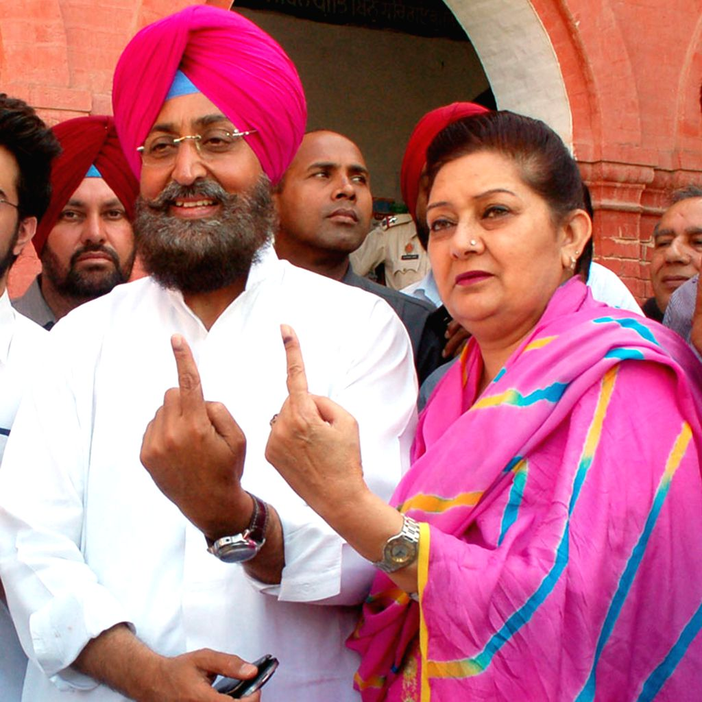 Punjab Congress chief and party's candidate from Gurdaspur Lok Sabha seat, Partap Singh Bajwa and his wife Charanjit Kaur Bajwa show their fore fingers marked with phosphorous ink after casting their - Charanjit Kaur Bajwa