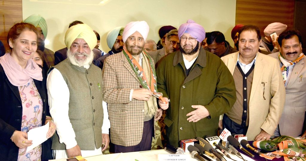Punjab Congress chief Captain Amrinder Singh addresses a press conference after AAP leader Daljit Singh joined the party in Amritsar, on Jan 14, 2017. Also - Amrinder Singh and Daljit Singh