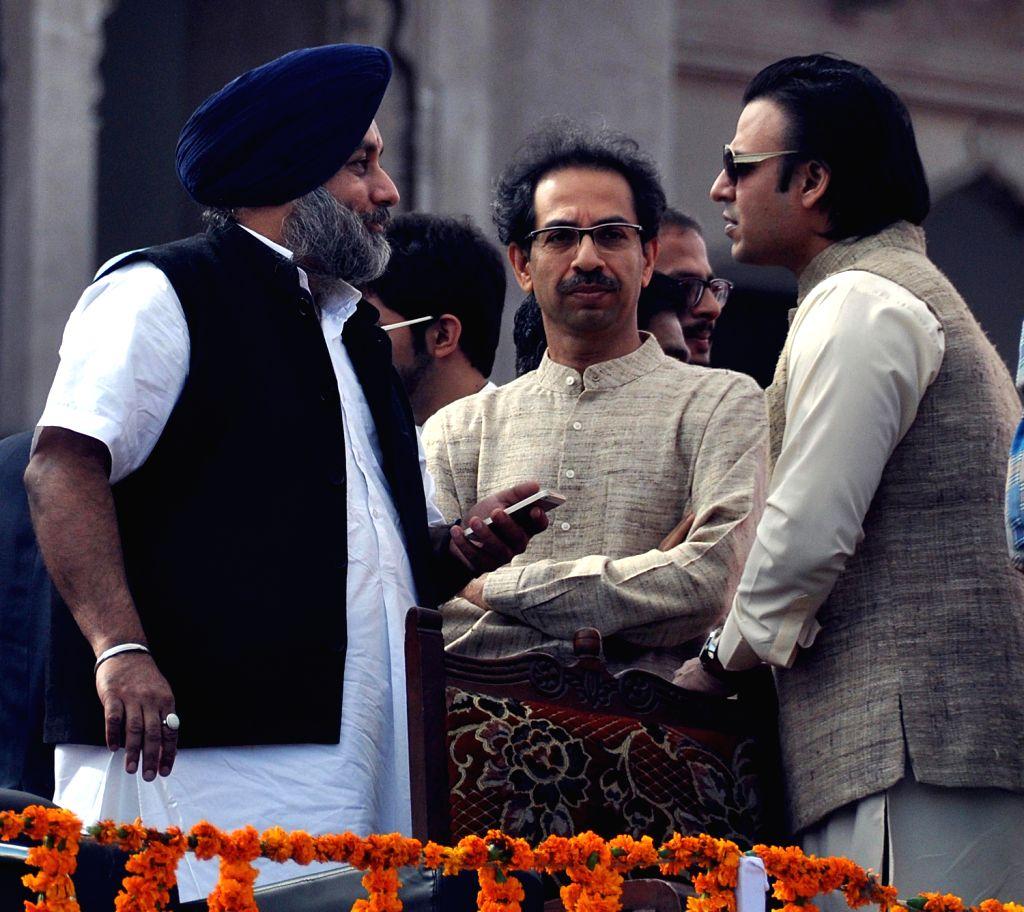 Punjab Deputy Chief Minister Sukhbir Singh Badal with Shiv Sena Chief Uddhav Thackeray during her swearing-in ceremony at Rajasthan Legislative Assembly in Jaipur on Dec.13, 2013. - Sukhbir Singh Badal