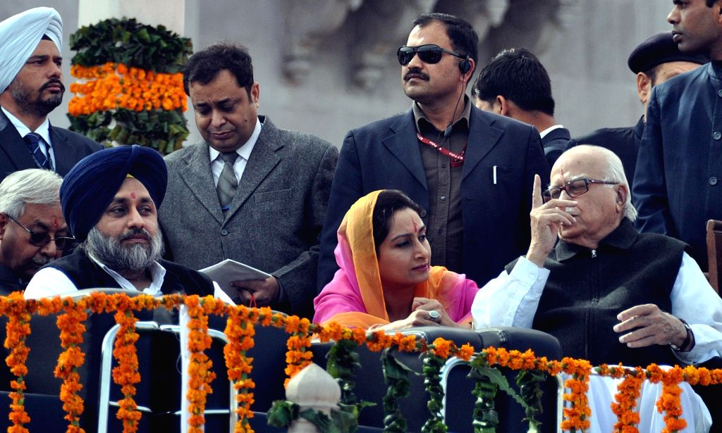 Punjab Deputy Chief Minister Sukhbir Singh Badal and his wife Harsimrat Kaur Badal with senior BJP leader L K Advani during swearing-in ceremony of newly elected Rajasthan Chief Minister Vasundhara .. - Sukhbir Singh Badal, Harsimrat Kaur Badal and L K Advani