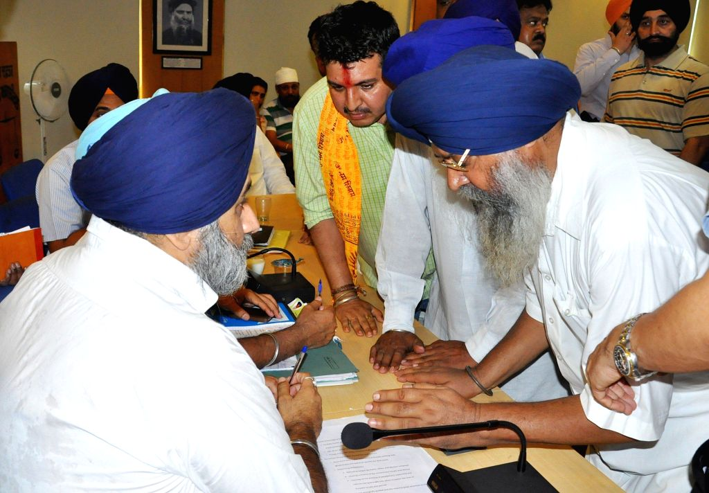 Punjab Deputy Chief Minister Sukhbir Singh Badal meets people during a programme in Chandigarh on June 18, 2014. - Sukhbir Singh Badal
