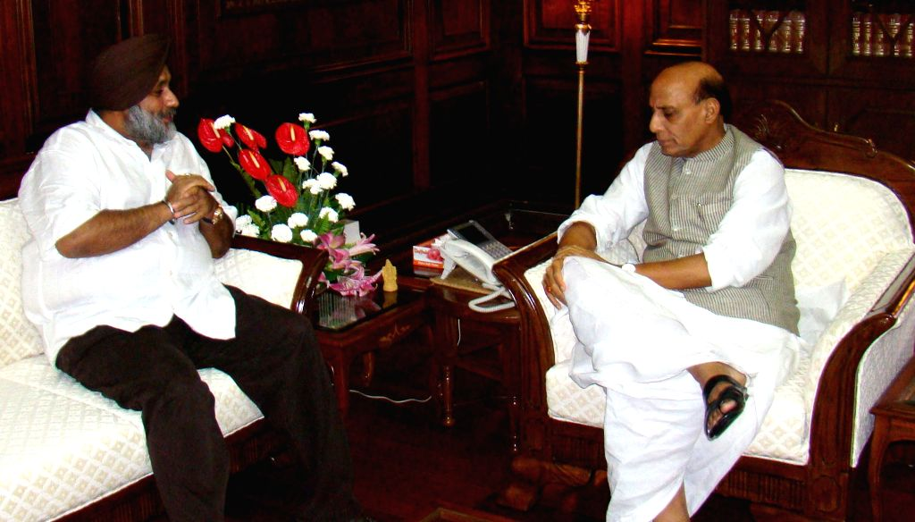 Punjab Deputy Chief Minister Sukhbir Singh Badal during a meeting with Union Home Minister Rajnath Singh in New Delhi on July 4, 2014.