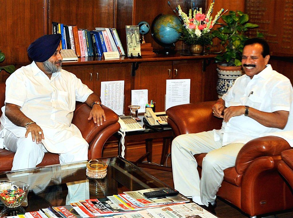Punjab Deputy Chief Minister Sukhbir Singh Badal during a meeting with Union Railway Minister D.V. Sadananda Gowda at Rail Bhawan in New Delhi on July 9, 2014.