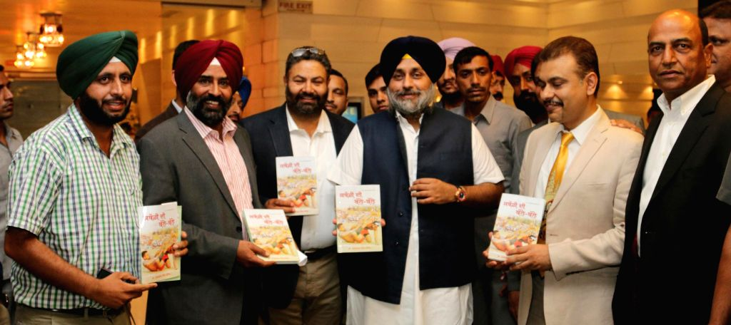 Punjab Deputy Chief Minister Sukhbir Singh Badal launches `Kabaddi Di Balle Balle` a book authored by Dr. Chahal in Chandigarh on July 25, 2014. - Sukhbir Singh Badal