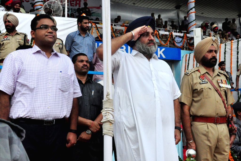 Punjab Deputy Chief Minister Sukhbir Singh Badal inspects the Guard of Honor on the occasion of 69th ``Independence Day`` celebration in Bathinda, on Aug 15, 2015. - Sukhbir Singh Badal