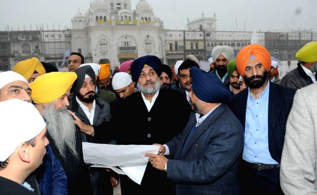 Punjab Deputy Chief Minister Sukhbir Singh Badal pays obeisance at the Golden Temple in Amritsar, on Jan 20, 2016.