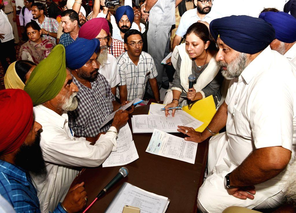 Punjab Deputy Chief Minister Sukhbir Singh Badal interacts with people during Sangat Darshan programme in Tanda near Hoshiarpur on June 30, 2016. - Sukhbir Singh Badal
