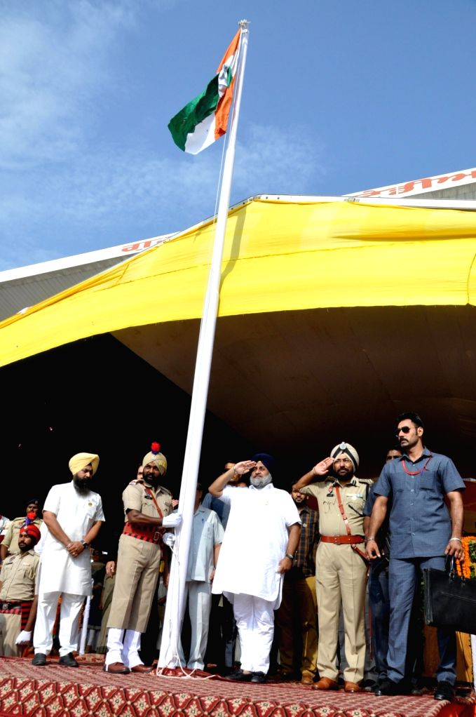 "Punjab Deputy Chief Minister Sukhbir Singh Badal salutes the national flag on the occasion of 70th ""Independence Day"" celebration in Amritsar on Aug 15, 2016. - Sukhbir Singh Badal"