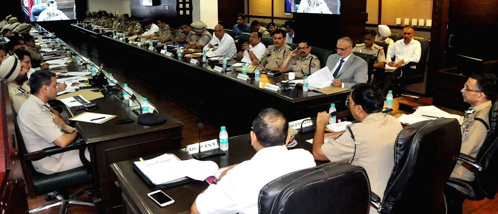 Punjab DGP Dinkar Gupta presides over a state level meeting with senior police officers of the state at Punjab Police Headquarters in Chandigarh on July 27, 2019. - Dinkar Gupta