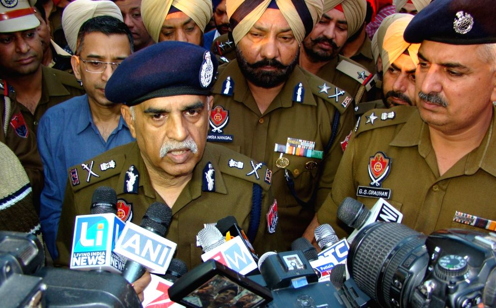 Punjab Director General of Police Suresh Arora talks to press regarding Nabha jail break on Nov 27, 2016.  Armed men attacked the maximum security Nabha jail in Punjab on Sunday and escaped ... - Suresh Arora and Harminder Singh Mintoo