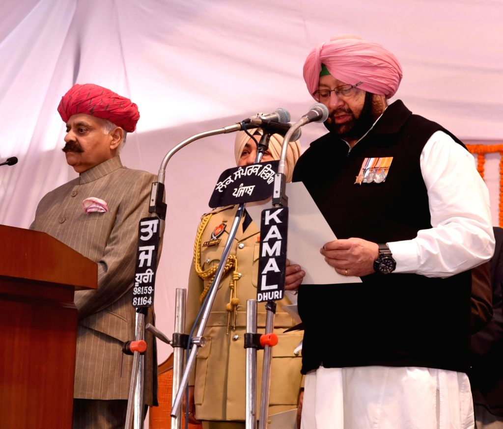 Punjab Governor VP Singh administer the oath to Captain Amarinder Singh as Chief Minister of Punjab during the swearing in ceremony in Chandigarh, on March 16, 2017. - Amarinder Singh