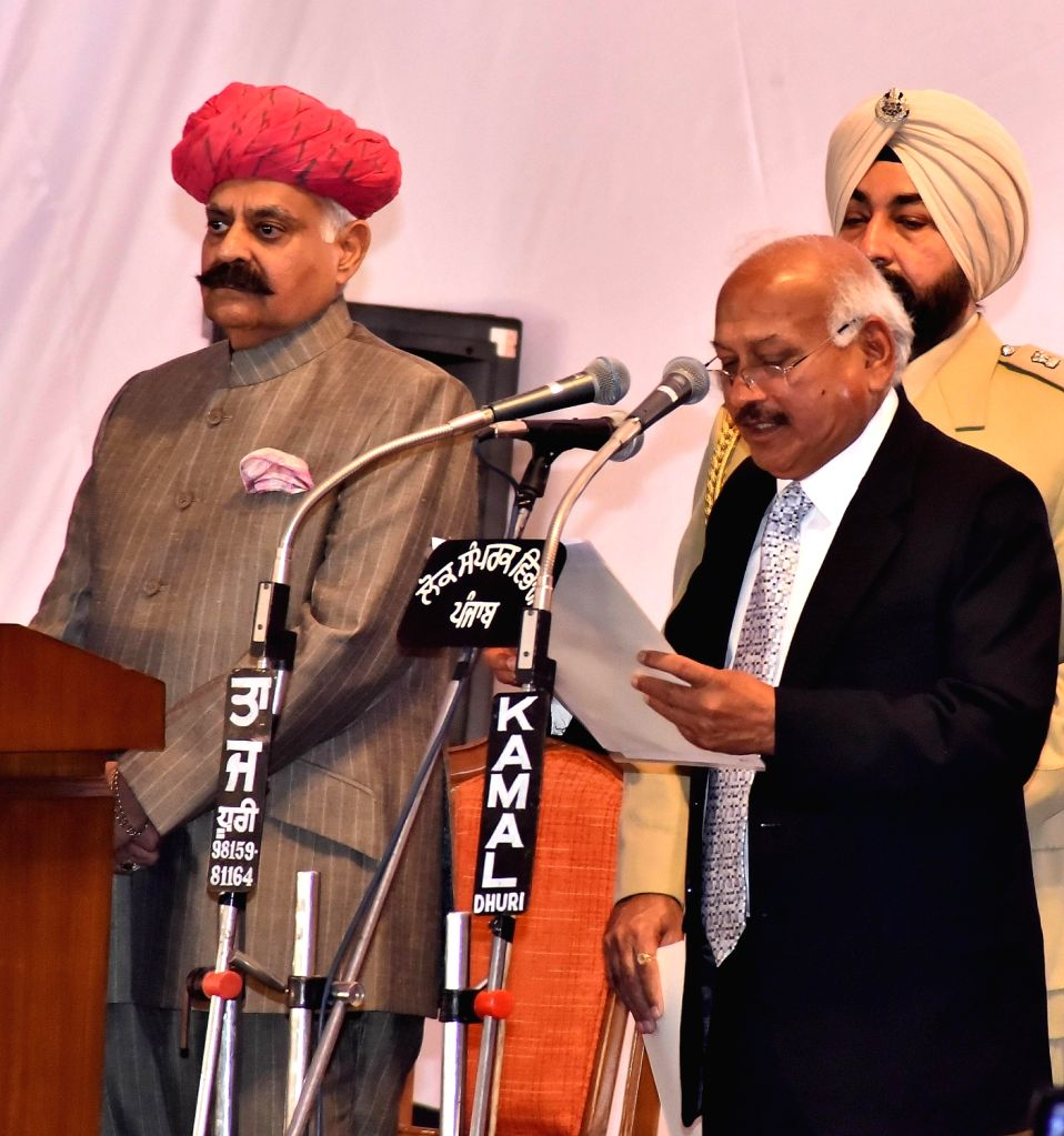 Punjab Governor VP Singh administer the oath to Brahm Mohindra as State cabinet minister during the swearing in ceremony in Chandigarh, on March 16, 2017.