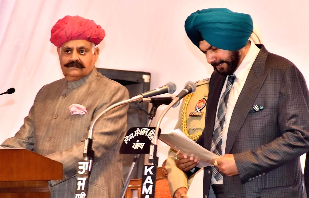 Punjab Governor VP Singh administer the oath to Navjot Singh Sidhu as State cabinet minister during the swearing in ceremony in Chandigarh, on March 16, 2017. - Navjot Singh Sidhu