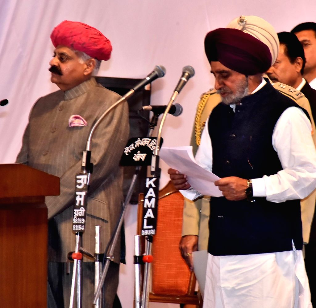Punjab Governor VP Singh administer the oath to Tripat Rajinder Singh Bajwa as State cabinet minister during the swearing in ceremony in Chandigarh, on March 16, 2017.