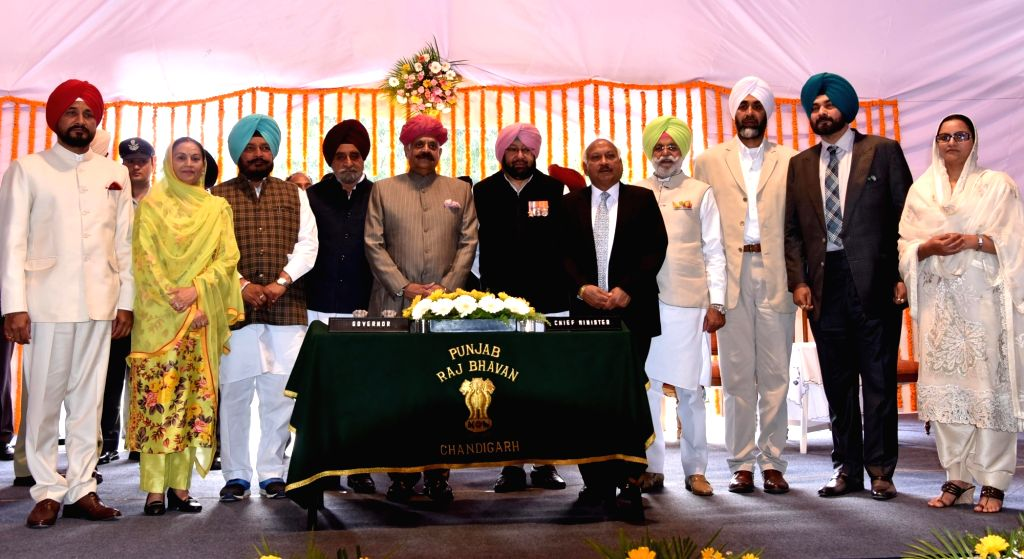 Punjab Governor VP Singh with State's new Chief Minister Captain Amarinder Singh and his nine cabinet ministers during the swearing in ceremony in Chandigarh, on March 16, 2017. - Captain Amarinder Singh