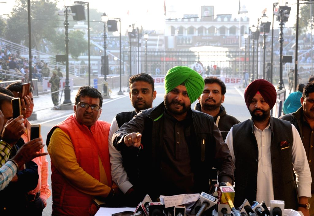 Punjab Minister and Congress leader Navjot Singh Siddhu addresses a press conference after returning back to India from Pakistan where he attended ground breaking ceremony of the Kartarpur ... - Navjot Singh Siddhu