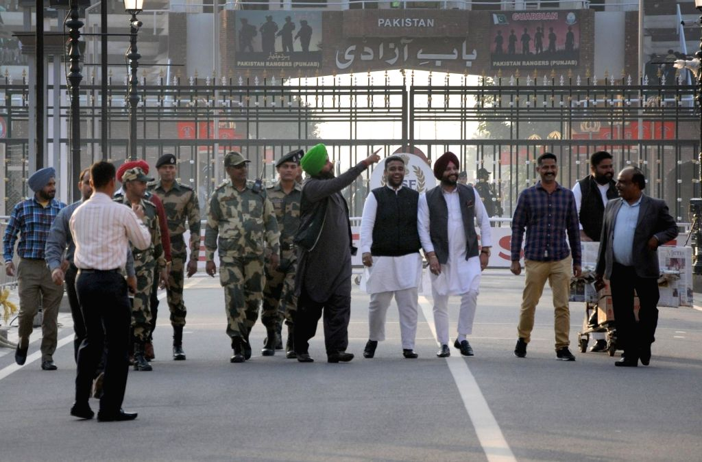 Punjab Minister and Congress leader Navjot Singh Sidhu returns back to India from Pakistan where he attended ground breaking ceremony of the Kartarpur Corridor, at Attri-Wagha border, Punjab ... - Navjot Singh Sidhu