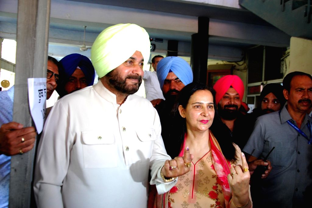 Punjab Minister Navjot Singh Sidhu and his wife Navjot Kaur Sidhu, show their forefinger marked with indelible ink after casting vote during the last phase of 2019 Lok Sabha polls, in ... - Navjot Singh Sidhu and Navjot Kaur Sidhu