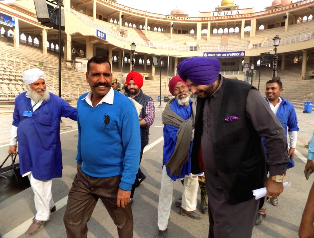 Punjab Minister Navjot Singh Sidhu on his way to Pakistan's Narowal to attend the ground breaking ceremony of KartarpurCorridor, in Punjab's Attari on Nov 27, 2018. - Navjot Singh Sidhu