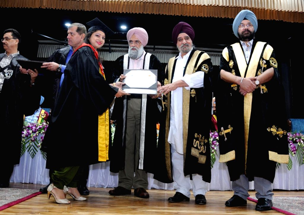 Punjab Minister Tripat Rajinder Singh Bajwa and Guru Nanak Dev University Vice Chancellor Jaspal Singh Sandhu give away degree to a student during the 50th convocation ceremony of the ... - Tripat Rajinder Singh Bajwa