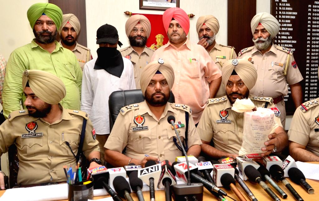 Punjab Police officials present before the press, heroine seized from a Nigerian national in Amritsar on Sept 19, 2017.