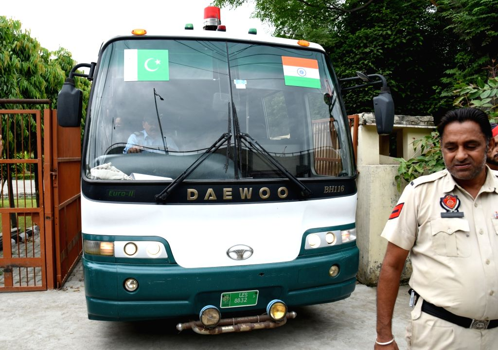 Punjab Police personnel escort a Pakistan Tourism Development Corporation (PTDC) bus that is returning to Lahore without passengers, in Amritsar on Aug 10, 2019. After suspending two ...