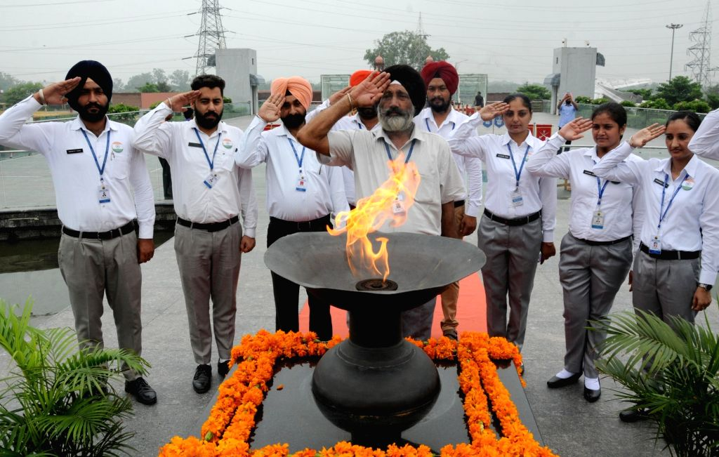 Punjab Police personnel pay tributes to the martyrs on 20th Anniversary of Kargil Vijay Diwas at the Punjab State War Heroes' Memorial and Museum, in Amritsar on July 26, 2019.