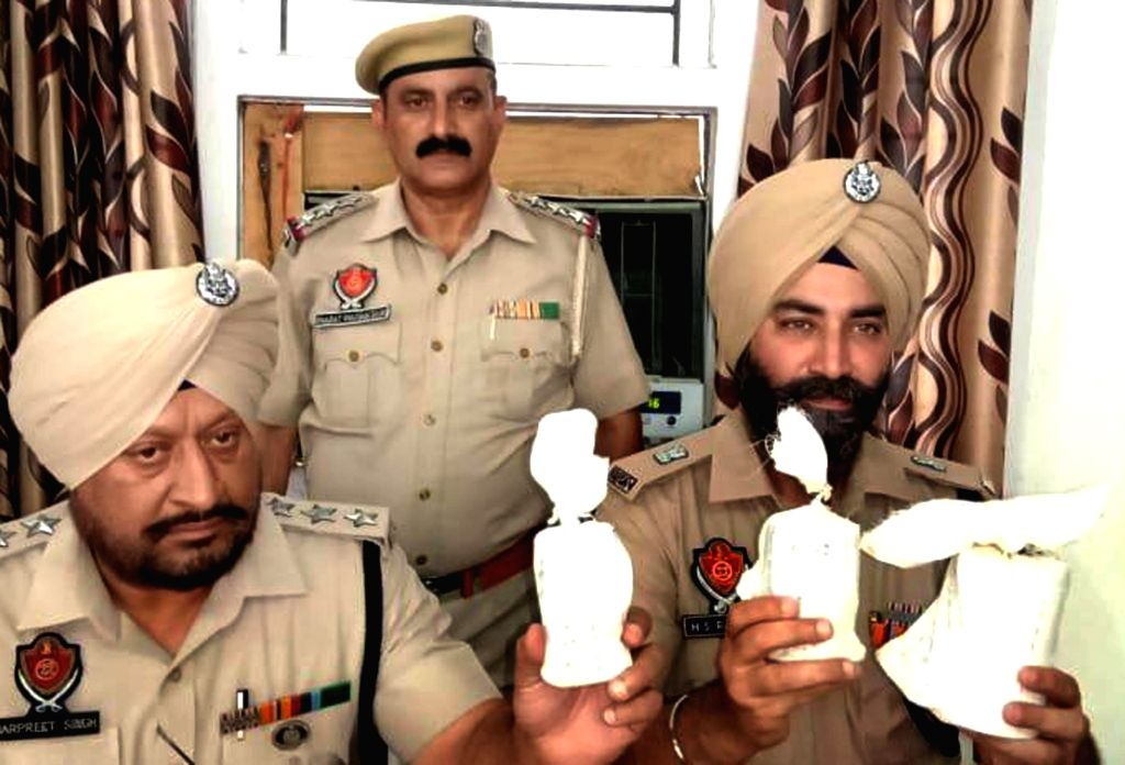 Punjab police show two hand grenades, seized while checking at Ajnala-Amritsar road, in Amritsar, on June 2, 2019.