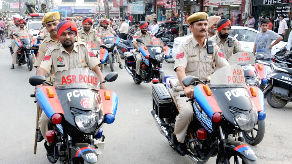 Punjab policemen conduct flag march in Amritsar on Oct 20, 2015.
