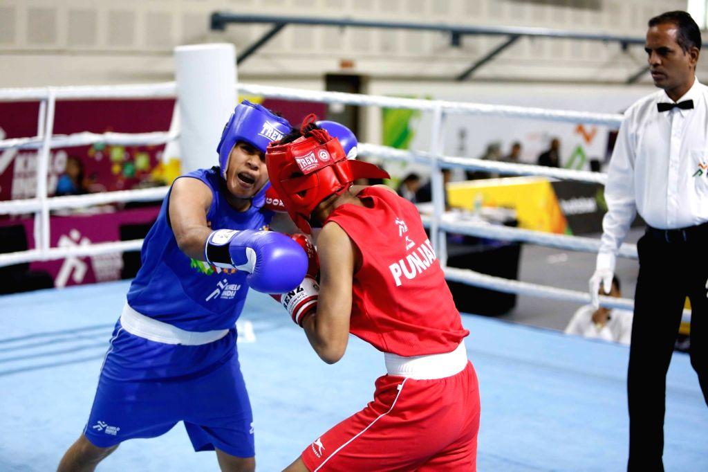 Punjab's Ekta Saroj and Haryana's Bharti in action during the 46kg class girls boxing quarterfinals at Khelo India School Games held at Indira Gandhi Indoor Stadium in New Delhi on Feb 6, ...