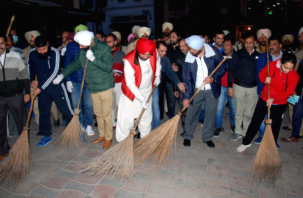 Punjab's Local Bodies Minister Navjot Singh Sidhu participates in a cleanliness drive near the Golden Temple in Amritsar on Jan 31, 2018. - Navjot Singh Sidhu