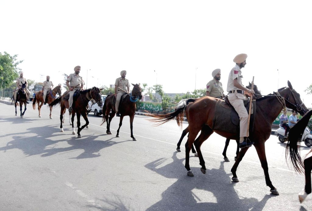 Punjab's mounted police conduct flag march on the eve of the 35th anniversary of Operation Blue Star, in Amritsar, on June 5, 2019.