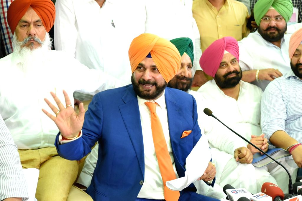 Punjab Tourism and Cultural Affairs Minister Navjot Singh Sidhu addresses a press conference in Chandigarh on June 23, 2017. - Navjot Singh Sidhu