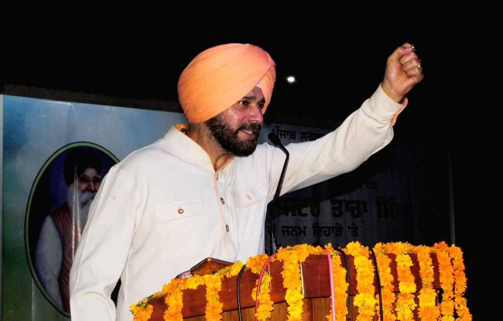 Punjab Tourism and Cultural Affairs Minister Navjot Singh Sidhu addresses during a programme organised to pay tribute to Sikh leader Master Tara Singh on his birth anniversary in Amritsar ... - Navjot Singh Sidhu and Tara Singh