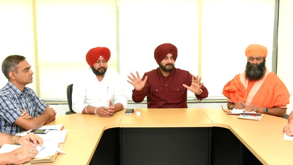 Punjab Tourism and Cultural Affairs Minister Navjot Singh Sidhu during a meeting in Chandigarh on Aug 10, 2017. - Navjot Singh Sidhu