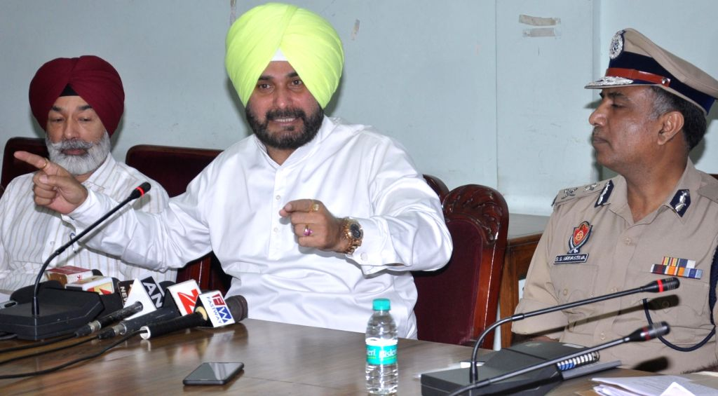 Punjab Tourism Minister Navjot Singh Sidhu addresses a press conference in Amritsar on Sept 10, 2017. - Navjot Singh Sidhu