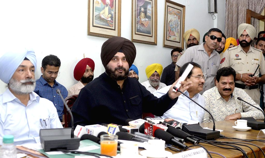 Punjab Tourism Minister Navjot Singh Sidhu addresses during a press conference in Amritsar on Sept 16, 2017. - Navjot Singh Sidhu