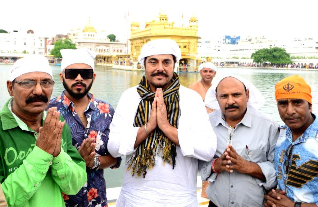 "Punjabi film ""AASRA"" actors Guggu Gill, Shubham Kashyap, Ashok Malohtra, producer Raj Kumar, assistant director Amrik pay obeisance at the Golden Temple in Amritsar on Sep 29, ... - Amrik, Guggu Gill, Shubham Kashyap, Ashok Malohtra and Kumar"