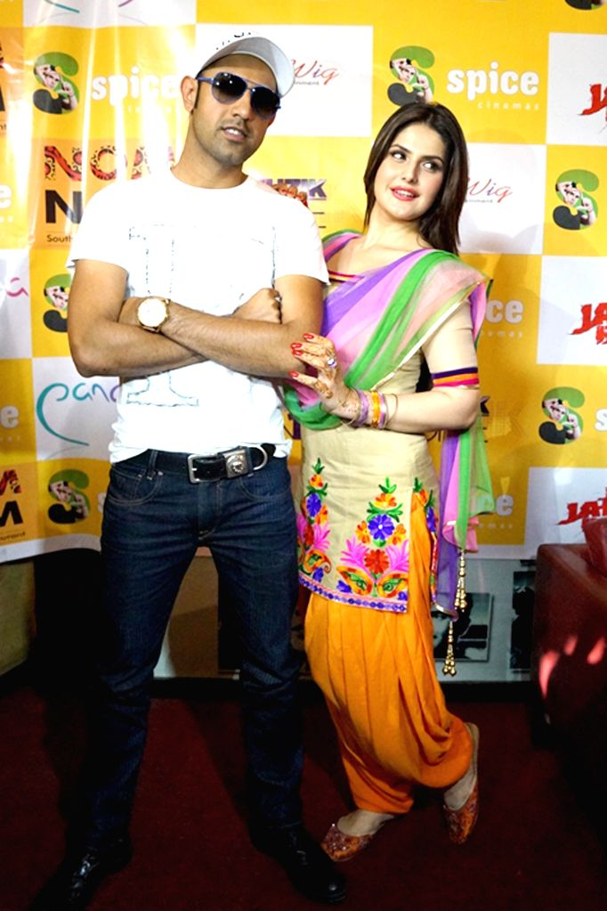Punjabi singer Gippy Grewal with actress Zarine Khan visited Spice Mall Noida for promotion of their film `Jatt James Bond` in Noida, Uttar Pradesh on April 17, 2014. - Zarine Khan