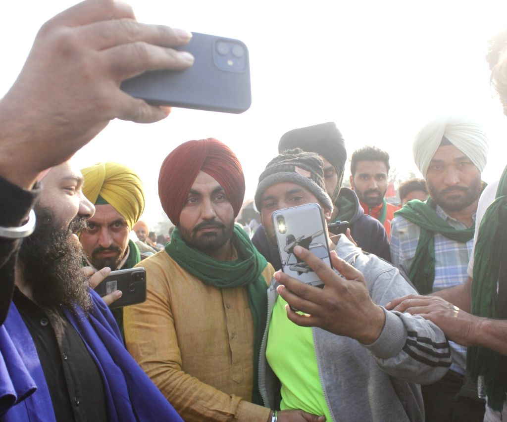 Punjabi singer Ravinder Grewal joins the farmers from Punjab and Haryana who continue to protest at the Delhi-Haryana's Singhu Border  for the seventh consecutive day, against the Central ...